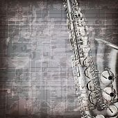 foto of sax  - abstract grunge gray music background with saxophone - JPG