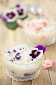 foto of edible  - Risoto prepared with edible flowers : violet and pink rose. ** Note: Shallow depth of field - JPG