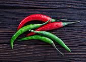 foto of chillies  - chilli peppers on the wooden table hot chilli - JPG