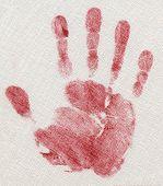 image of dna fingerprinting  - red hand print isolated on linen fabric - JPG
