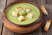 pic of vegetarian meal  - Organic green cream soup vegetarian lunch in bowl on vintage wooden background - JPG