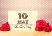 stock photo of carnation  - Mothers Day May 10th Card with Carnation Flowers on Top of a Wooden Table - JPG