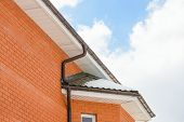 image of downspouts  - chimney on the roof of the house against the blue sky - JPG