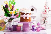 foto of cake stand  - Easter cake on the cake stand and flowers - JPG