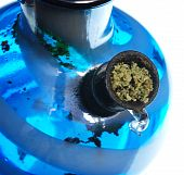 image of bong  - Bowl of ground cannabis leaves in a water bong - JPG