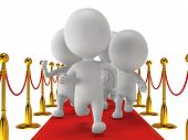 stock photo of chase  - People run on red event carpet with golden rope barriers - JPG