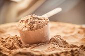 picture of food  - Whey protein scoop. Sports nutrition food after gym.