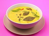 pic of curry chicken  - Hot and spicy chicken green curry on a pink background - JPG