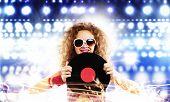 pic of disc jockey  - Young pretty girl dj at disco party holding vinyl - JPG