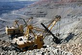image of mines  - Heavy mining truck on the iron ore opencast mining quarry - JPG