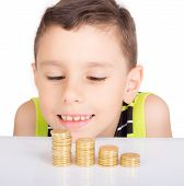 stock photo of stare  - young boy staring and counting his coins - JPG