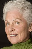 stock photo of 55-60 years old  - head shot of a beautiful 55 to 60 year old woman against a black background - JPG