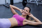 foto of crunch  - Portrait of a muscular woman doing abdominal crunch - JPG