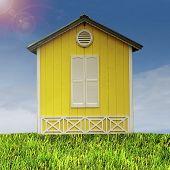 Yellow hut on a green field