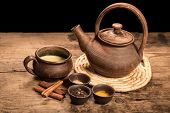 picture of darjeeling  - Masala tea with spices on dark wooden table - JPG