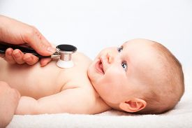 picture of beating-heart  - Pediatrician examines three month baby girl - JPG