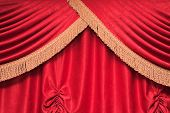 stock photo of fimbriae  - Background of red theater curtain with pleats and golden fimbria - JPG