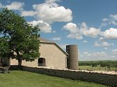 stock photo of tallgrass  - Picture of a barn built in 1881 out of native Kansas limestone - JPG