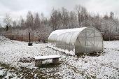 plastic hothouse in winter garden