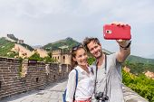 Happy couple tourists taking selfie picture at Great wall of China, top worldwide tourist destinatio poster