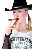 portrait of sexy cowgirl with cigar in white background