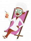 Young woman with face mask and towel on her head lying in beauty salon. Woman relaxing in beauty sal poster