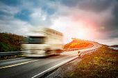 Truck and highway at sunset. Truck Car in motion blur. Atlantic Ocean Road or the Atlantic Road (Atl poster