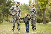Military family reunited on a sunny day poster