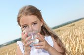 image of drinking water  - Closeup of little blonde girl drinking water - JPG