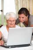 Elderly woman learning how to use computer