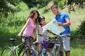 stock photo of family vacations  - Family on a bicycle ride - JPG