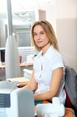 Blond businesswoman working in the office