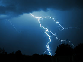 stock photo of lightning bolt  - powerful lightning strike in the darkness during thunderstorm - JPG