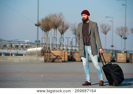 poster of Hipster Ready Enjoy Travel. Carry Travel Bag. Business Trip. Man Bearded Hipster Travel With Big Lug