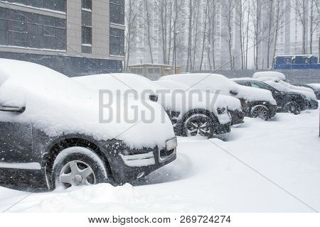 Vehicles Covered With Snow In