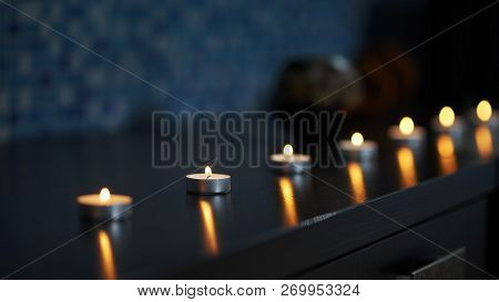 poster of Aroma Candles Staying On Table, Burning In Darkness And Created Antistressing And Peaceful Atmospher