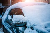Snow-covered Car. Winter Parking. Rearview Mirror Covered With Snow. Transport After Snowfall. poster