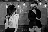 Lady Teacher And Bearded Hipster Schoolmaster Working Together In School. Generation Concept. Man Wi poster