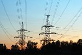 transmission line towers at sunrise
