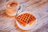 Belgian Waffles With Syrup. The Concept Of A Slow Breakfast. Breakfast. Cappuccino. Beige Wooden Bac poster