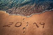 Happy New Year 2019 Concept Written On The Sea Beach At Sunrise poster