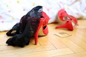 Red Shoes On High Heels, Black Lace Panties And A Condom On The Wooden Floor Near The Bed. Quick Sex poster