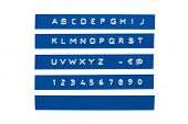 Embossed alphabet on blue plastic tape