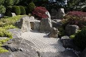 View Of A Japanese Garden With Gravel Paths