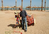 Egyptian man with his camel
