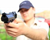 image of glock  - Young man holding gun - JPG