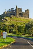 Cashel sign with Rock of Cashel in background - Ireland