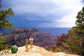 Tourist family in Grand Canyon - North Rim
