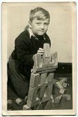 Vintage photo of boy with building bricks (early fifties)