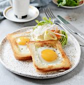 American Breakfast On A Plate With Fried Eggs In Toast, With Tomatoes, Fresh Daikon, Carrots, Arugul poster